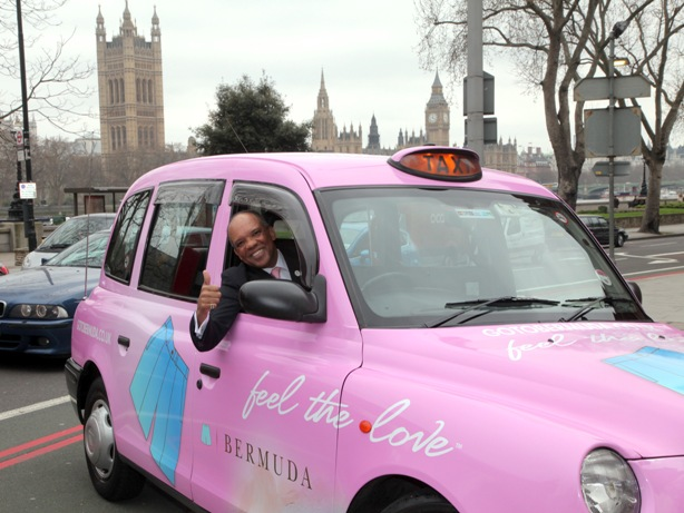 Premier Dr. Ewart Brown with a Pink London Taxi; part of Bermuda's marketing