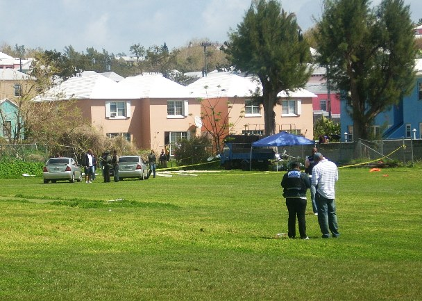 The police examining the scene immediately following the murder