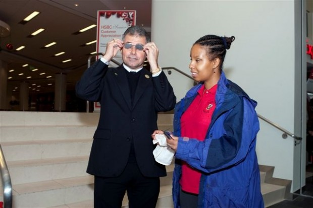 Minister De Silva adjusting glasses