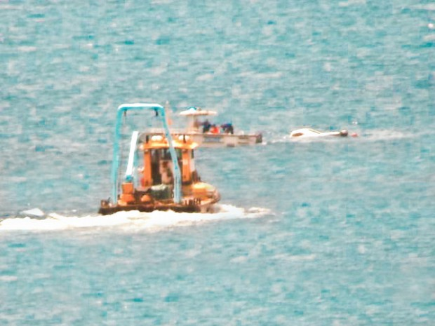 Photos released police rescue boaters bernews for Fishing in bermuda