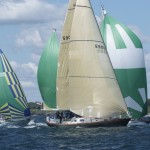 2012 Newport Bermuda Yacht Race -start in Narragansett Bay. Cetacea, a Hinckley SW 59 cruising yacht, holding her own against spinnaker flying rivals in Class 12