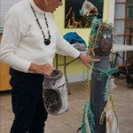 Judie Clee with art made from plastic marine debris