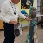 Judie Clee with art made from plastic marine debris
