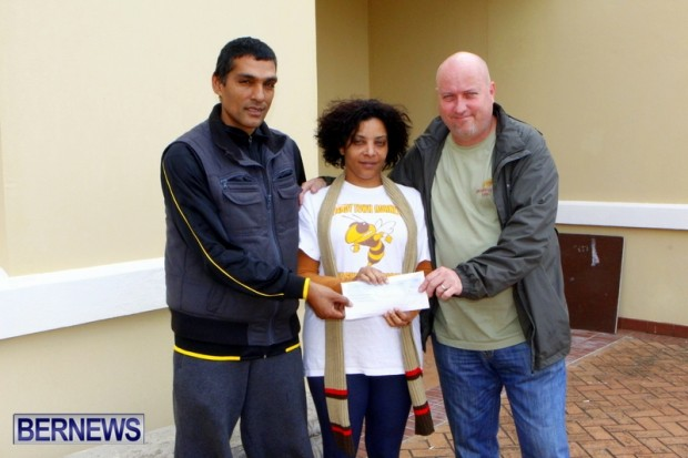 eclan Harris & Rowan Ramotar presented Dandy Town representative Kewanna Swan