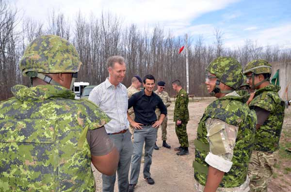 Governor And Senator Visit Troops In Canada
