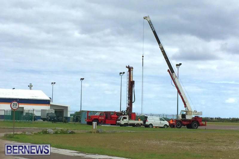 Crews work near the airport's North Ramp today