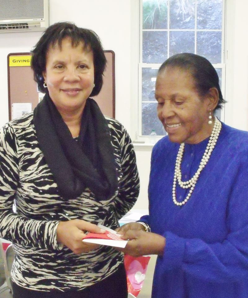160203 (3) Wenona Hodgson (right) presents JoAnn Walker with Holy Trinity Church's $1500 donation to Age Concern.