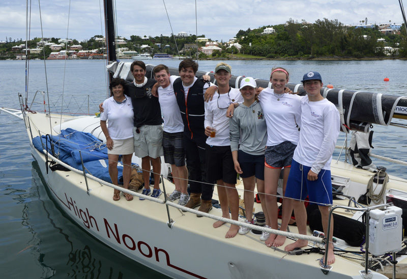 2016 Newport Bermuda Yacht Race finish. HIGH NOON,  a Tripp 41 skippered by Peter Becker and crewed by 7 young sailors aged between 15 and 18. Standing from left to right next to Leatrice Oatley, Commodore of the Royal Bermuda YC who presented each youngs