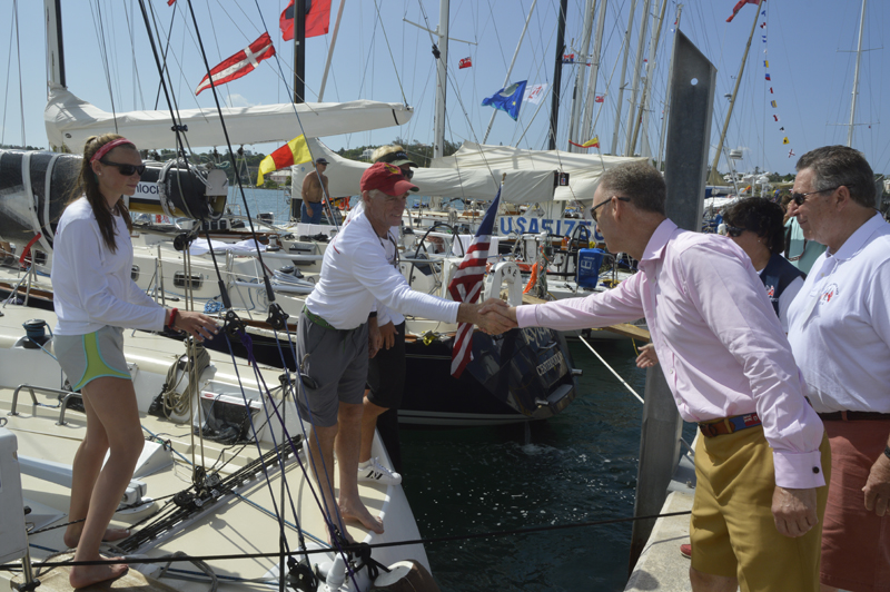 2016 Newport Bermuda Yacht Race. Governor General's tour of the Bermuda Race yachts moored at the RBYC. His Excellency, the Governor of Bermuda, George Fergusson meeting Peter Becker, skipper of HIGH NOON, and his daughter Carina.