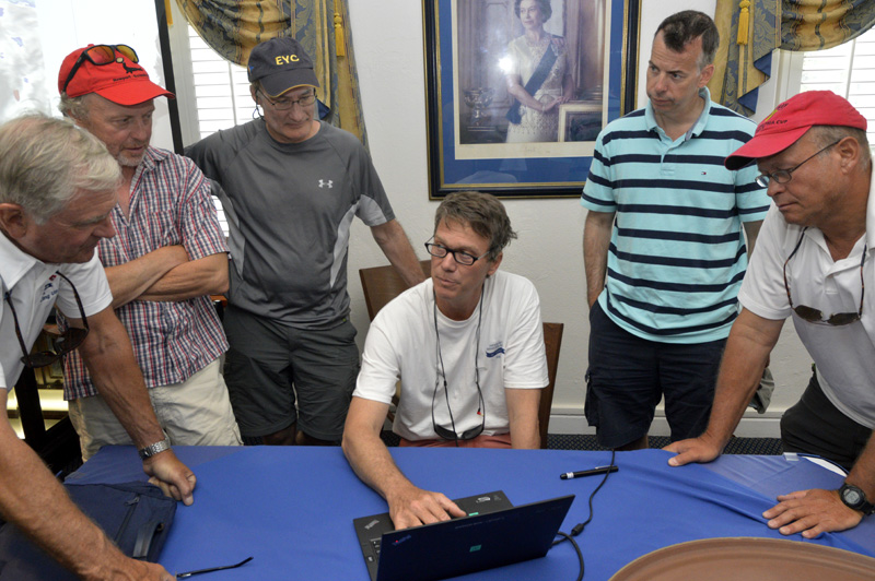 2016 Newport Bermuda Yacht Race Finish. 2016 Newport Bermuda Yacht Race. Navigators conference at the Royal Bermuda YC.  H L Devore, navigator on the St David's Lighthouse trophy winning yacht WARROR WON, shares computer weather and Gulf Stream data with