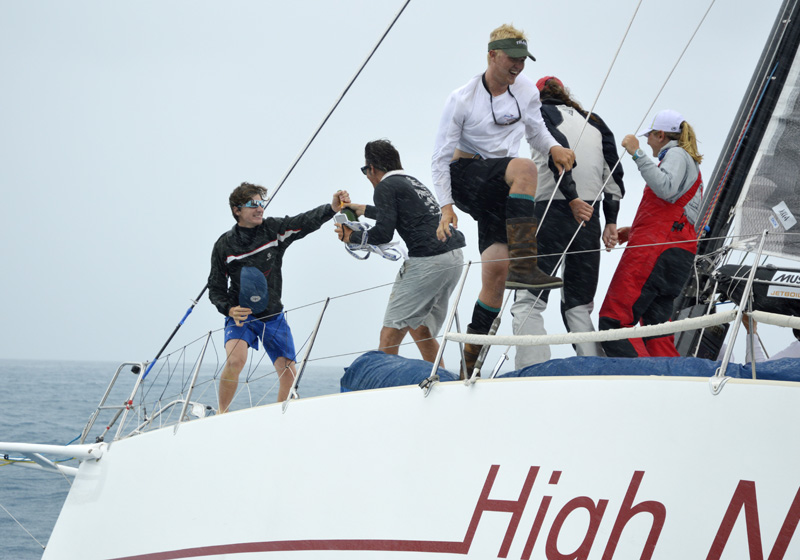 2016 Newport Bermuda Yacht Race finish.  High Five! ... Young crew on HIGH NOON,  a Tripp 41 skippered by Peter Becker celebrating a remarkable line honors victory among the traditional yachts. She was crewed by 7 young sailors aged between 16 and 18.