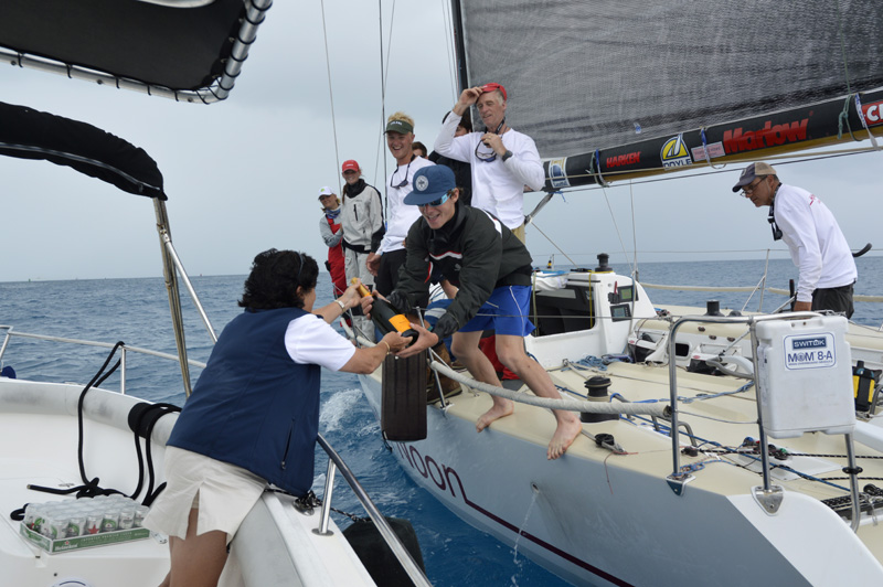 2016 Newport Bermuda Yacht Race finish. HIGH NOON,  a Tripp 41 skippered by Peter Becker and crewed by 7 young sailors aged between 15 and 18. Traditional elapsed time winners. Helm: Carina Becker. Royal Bermuda YC Commodore Leatrice Oatley hands over the