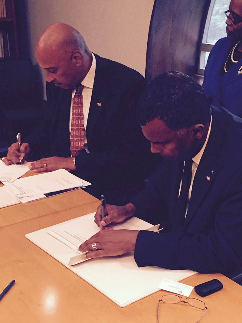 Minister Mitchell of The Bahamas signs the Hamilton Declaration