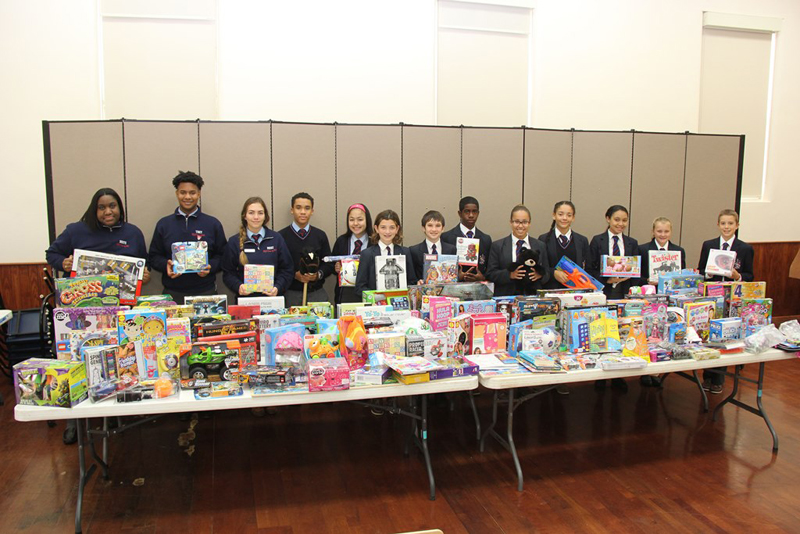 Saltus cheque & toys to Salvation Army Bermud Dec 15 2016 (1)