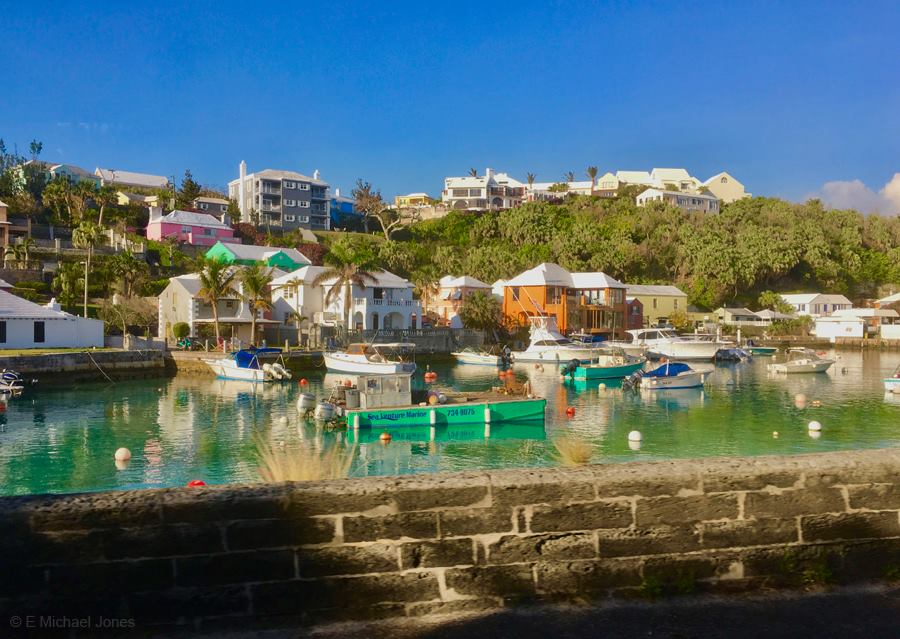 A serene morning in Bermuda, with boats at rest & colorful houses