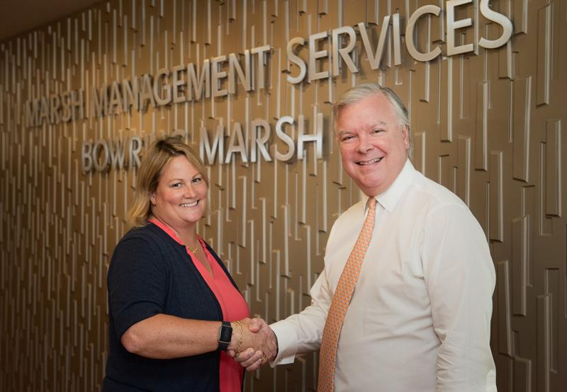 Marsh donate to WindReach Bermuda July 25 2017
