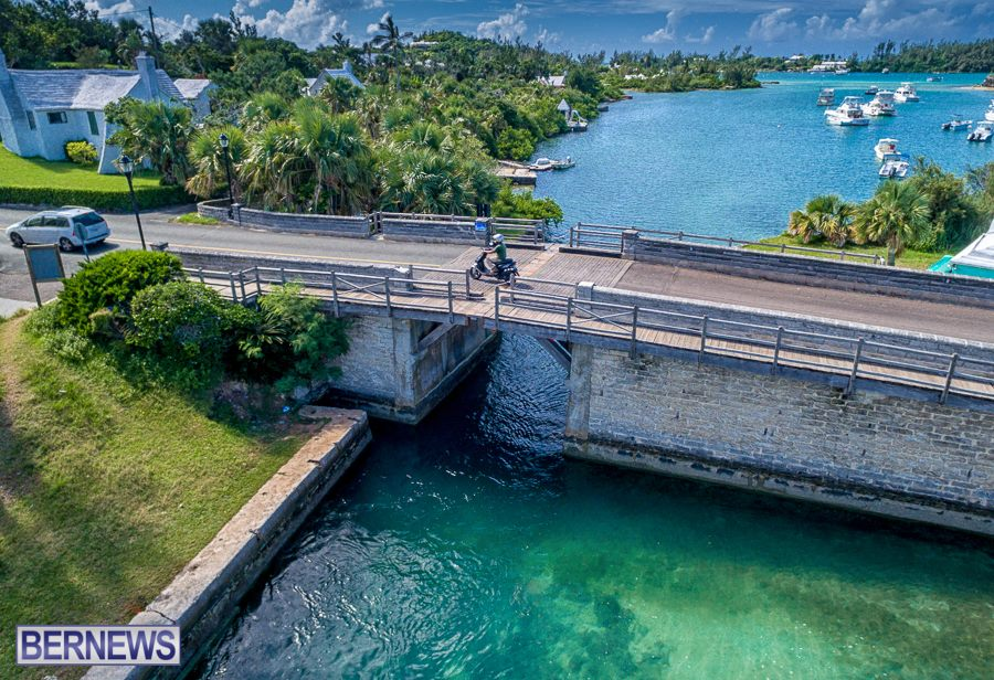 345 A moped traverses the world's smallest drawbridge in Sandys