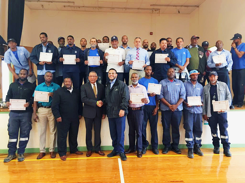 Public Works & Belco workmen with Minister David Burch Bermuda Nov 2018