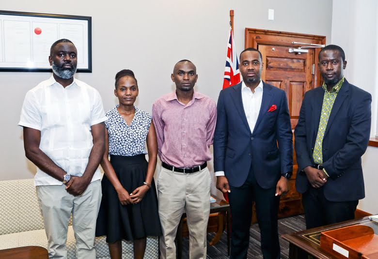 Paul and sister Leah with Premier David Burt and Minister Wayne Caines