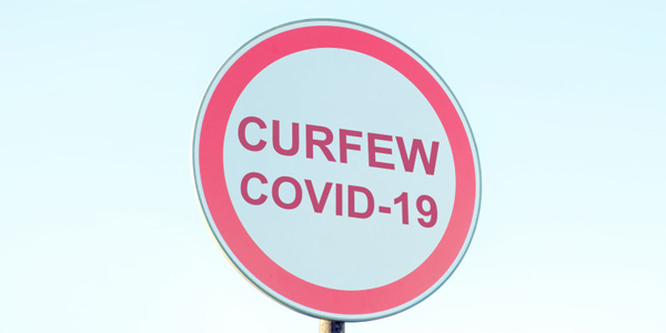 street sign with curfew virus covid-19 generic a984kh6kw TWFB
