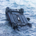 Photos: Car Overboard, Driver Rescued
