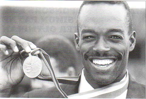 Nicky Saunders in 1990 with his Commonwealth Gold Medal. Photo: Olympics.bm