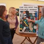 Anne Hyde KBB ED points out fish bites on plastice marine debris