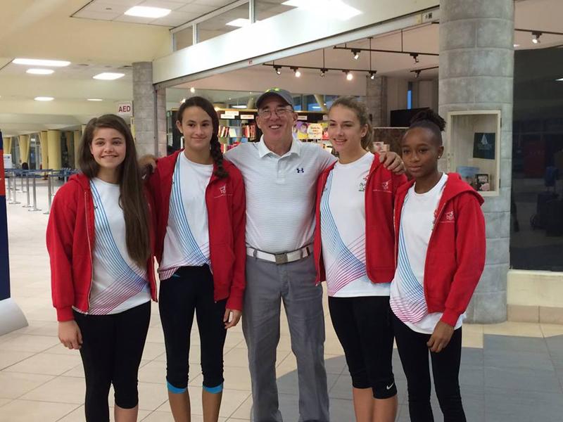 PAGU gymnasts with Coach Duke