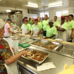 Employees help to prepare food at Meals on Wheels