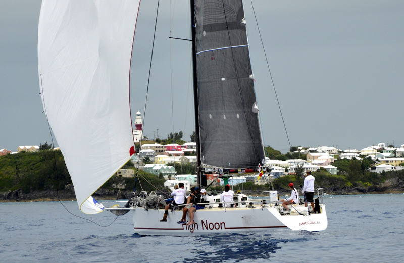 2016 Newport Bermuda Yacht Race finish. HIGH NOON,  a Tripp 41 skippered by Peter Becker and crewed by 7 young sailors aged between 15 and 18. sneaks over the St David's Lighthouse finish line to take elapsed time honours within the traditional fleet.