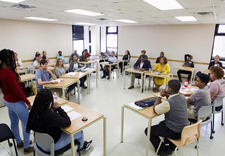 Minister Judges Bermuda College Student Debate - Bernews