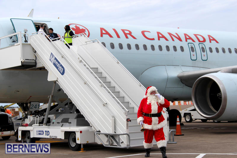 Santa Arrives At Airport Bermuda, December 24 2017_2-3