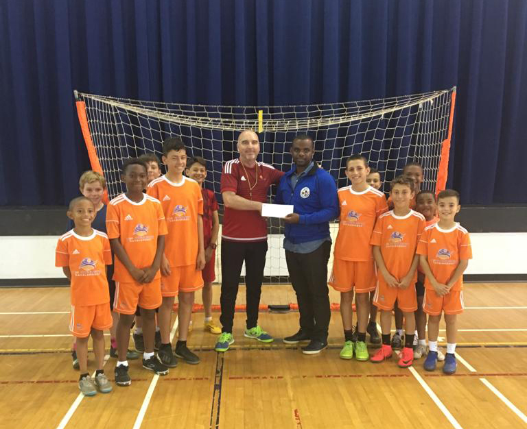 Corporate Futsal Challenge Cheque Presentation Bermuda April 2019