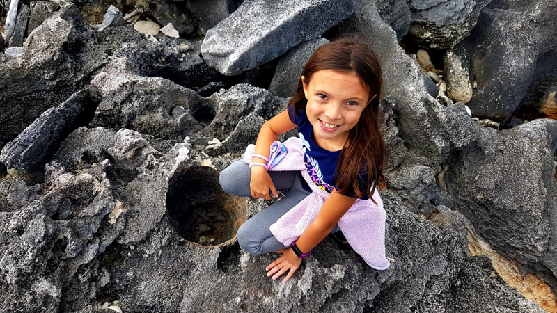 Milena with fossilized tree trunk Bermuda Jan 2021