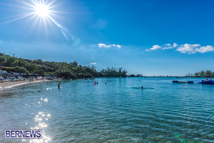 220 - Visitors swim in the shallow waters, late afternoon at Grotto Bay