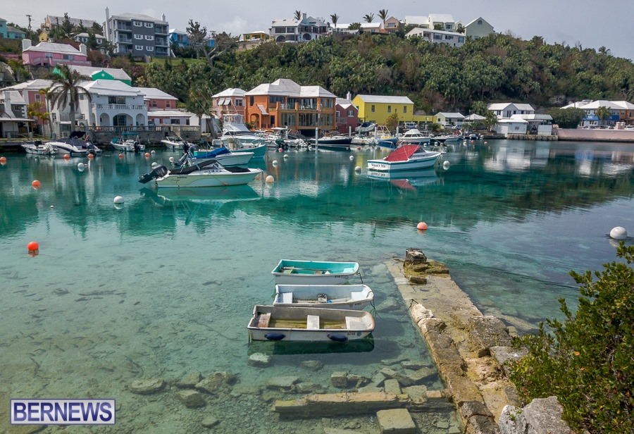506 - Pastel buildings and clear calm waters in Flatt's Inlet